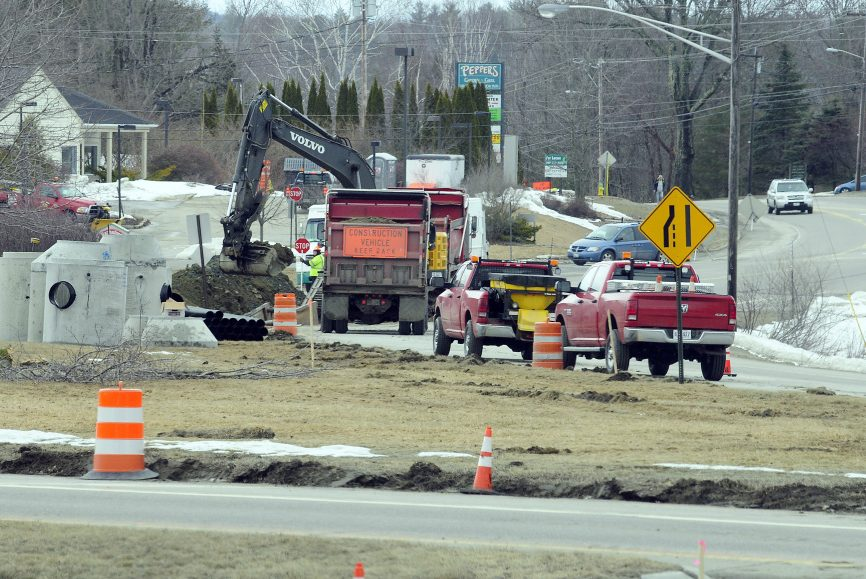 Construction workers dig up the intersection of Main Street and U.S. Route 202 on Wednesday in Winthrop.