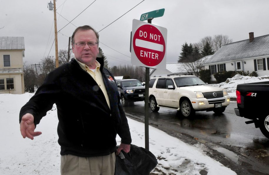Skowhegan Road Commissioner Greg Dore stands Wednesday at the intersection of Gem Street and North Avenue in Skowhegan, where Gem Street will become a one-way road on April 17. The change is a result of congestion on the two-way street and complaints from residents.
