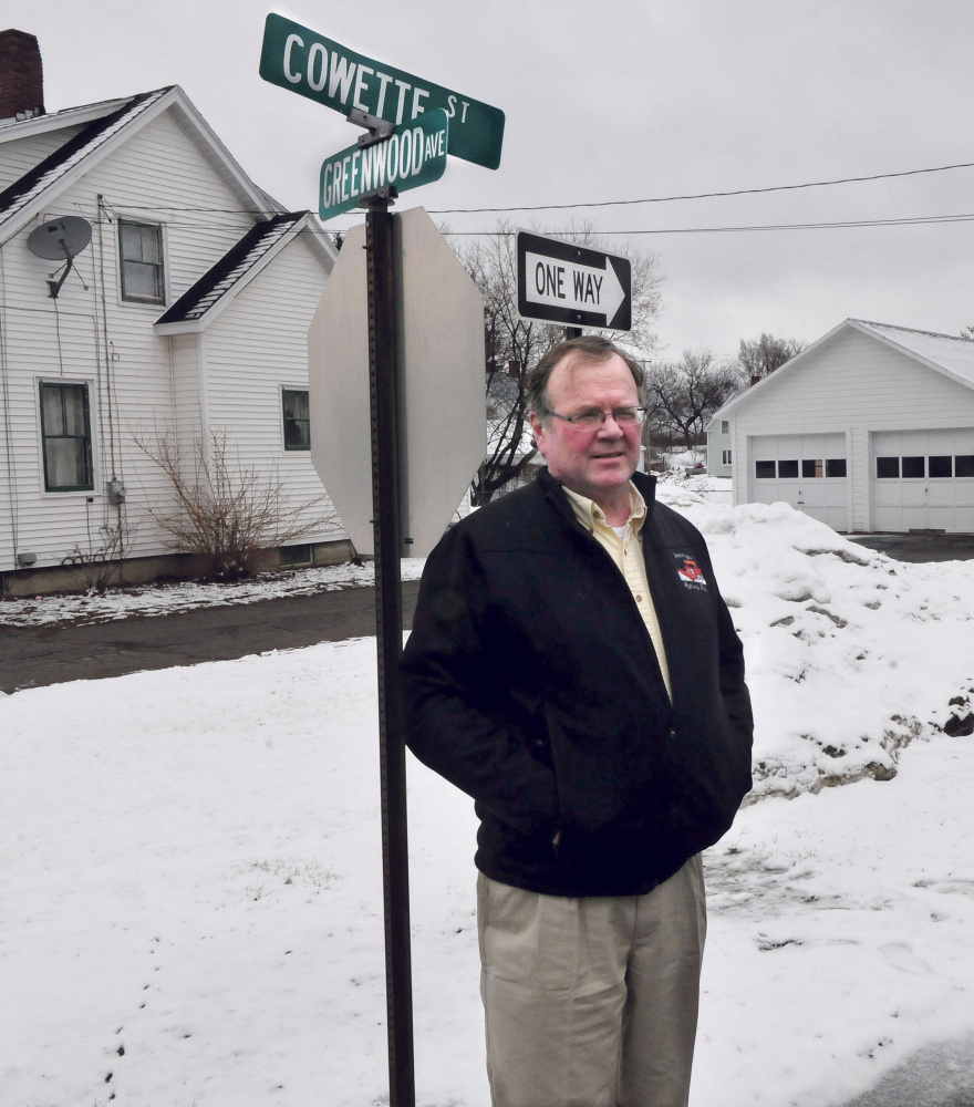 Skowhegan Road Commissioner Greg Dore stands Wednesday at the intersection of Cowette and Greenwood Streets in Skowhegan. Cowette and nearby Gem Street will become a one-way street on April 17. The change is a result of congestion on the two-way street and complaints from residents.