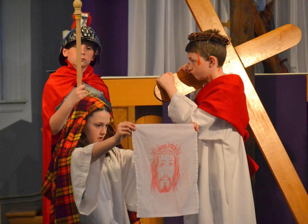 Contributed photo A Living Stations of the Cross recently was held at St. Mary's Church in Presque Isle. Lauren Dugal, portraying Veronica, in front; with Chase Plourde, as the guard; and Augustus Bonner, as Jesus.