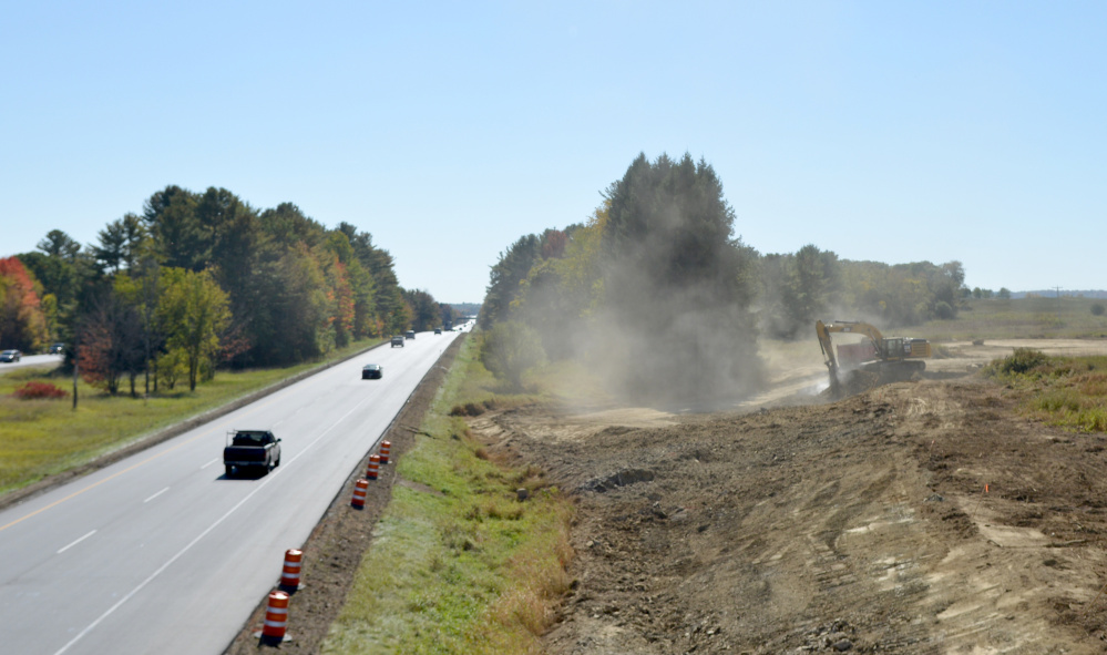 Construction crews work on the southbound Trafton Road interchange on Intestate 95 in Waterville on Oct. 7, 2016. Work on the interchange is resuming Tuesday and expected to be completed by the end of June.
