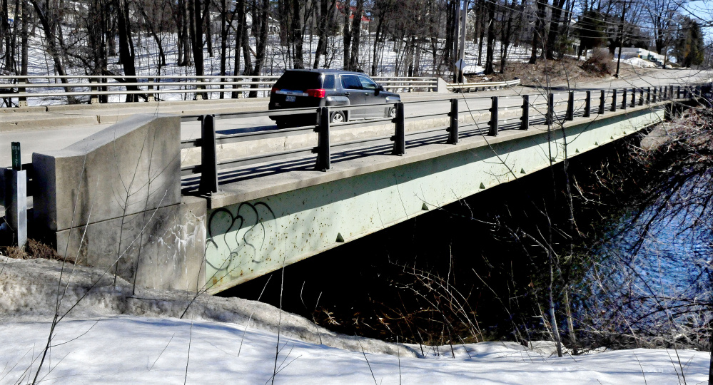 Traffic passes over Thayer Memorial Bridge on Gilman Street in Waterville on March 23. A planned $1 million rehabilitation project for the bridge is being postponed until the summer of 2018.