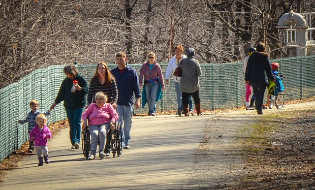 Dozens of people mobbed the Kennebec River Rail Trail in Augusta on Sunday as temperatures warmed up and the sun came out.