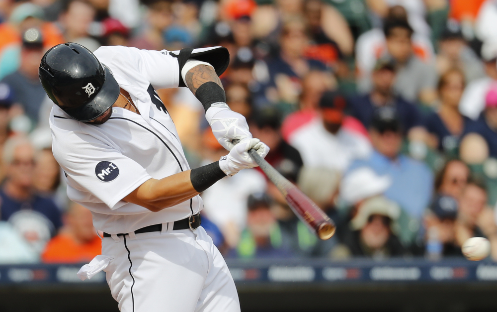 Detroit Tigers outfielder Nicholas Castellanos hits an RBI single off Boston pitcher Chris Sale in the eighth inning Monday.