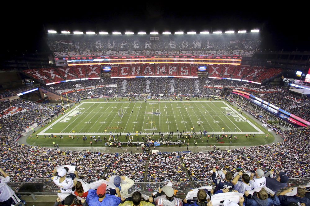 In this  Sept. 10, 2015, file photo, Patriots fans perform a card stunt commemorating their Super Bowl win before a game against the Steelers, at Gillette Stadium in Foxborough, Massachusetts. 2026 World Cup soccer games could be played in a number of modern stadiums across North America, including Gillette Stadium.