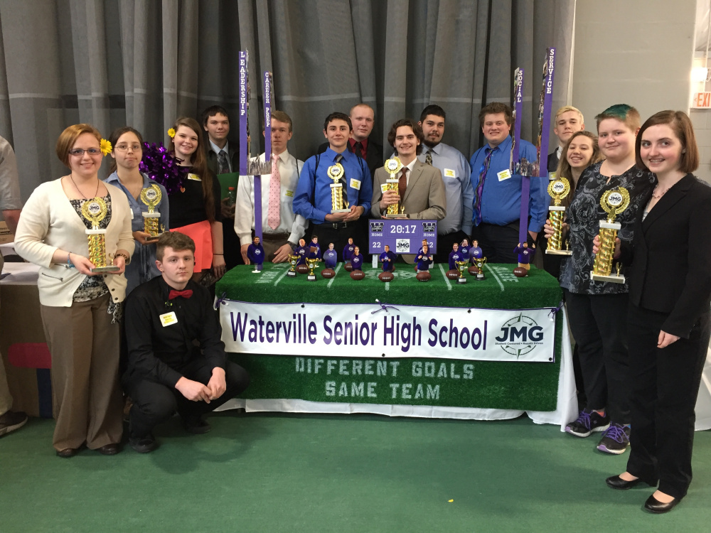 Waterville Senior High School stand in front of their trophies at the Jobs for Maine's Graduates' Career Development Conference. From left are Rose Vought, Jacob Taylor (kneeling), Julia Schutz, Tasha Kavis, Nate Morgan, Cody Quirion, Kory Drake, Donnavon Doughty, Nicareece Hunter, Sulley Menz, Gareth Belton, Jackson Aldrich, Sage Hafenecker, Makalah McIntire and Alissah Paquette.