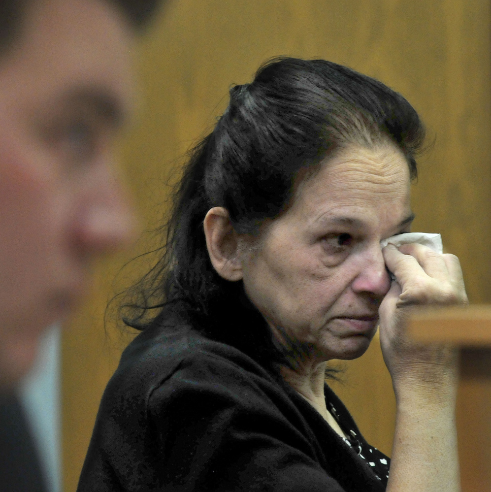 Linda Janeski, current owner of a dog named Dakota that has been ordered to be euthanized after repeated attacks on other dogs, wipes away tears Tuesday after Judge Valerie Stanfill refused to reverse the decision in Waterville District Court.