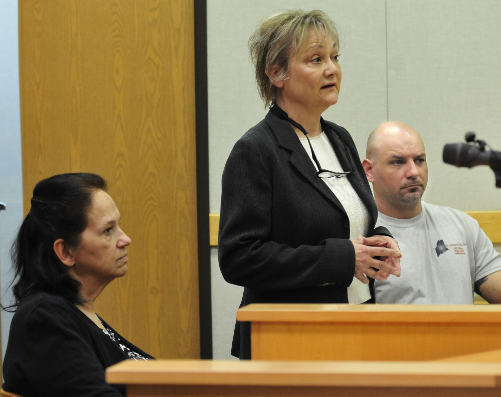 Staff photo by David Leaming Linda Janeski, left, current owner of a dog named Dakota, attorney Bonnie Martinolich and previous dog owner Matthew Perry attend a hearing Tuesday in Waterville District Court to see if the court-ordered euthanasia ruling about the dog for repeated attacks on other dogs would be reversed. Judge Valerie Stanfill refused to change the original decision.