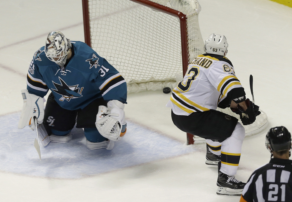 Boston left wing Brad Marchand, right, scores the winning goal on San Jose Sharks goalie Martin Jones during overtime of a game earlier this season in San Jose, California. The 5-foot-9, 181-pound forward, who was suspended for the last two games for spearing, will lead the Bruins in their opening-round series tonight at Ottawa.