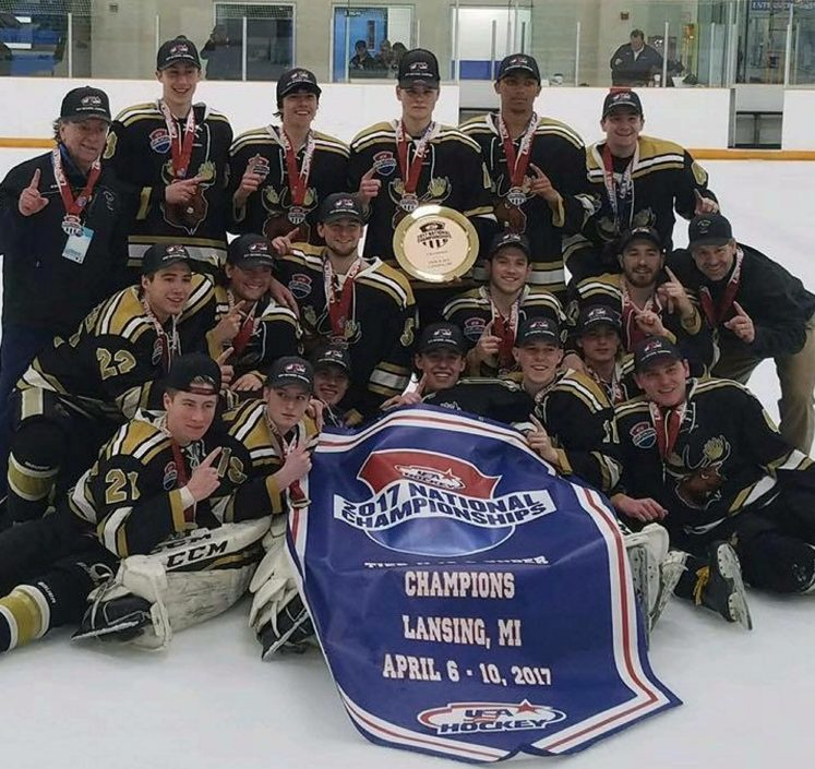 The Maine Moose 18U team celebrates after winning the Tier II 2A junior hockey national championship Monday in East Lansing, Michigan.