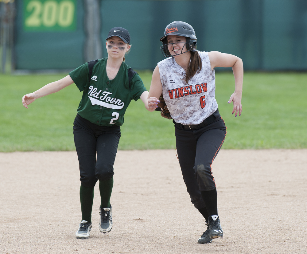Winslow baserunner Kylee Morrissette is tagged out by Old Town's Olivia Westure during a run-down in the 6th inning of the Class B North title game last season in Brewer.
