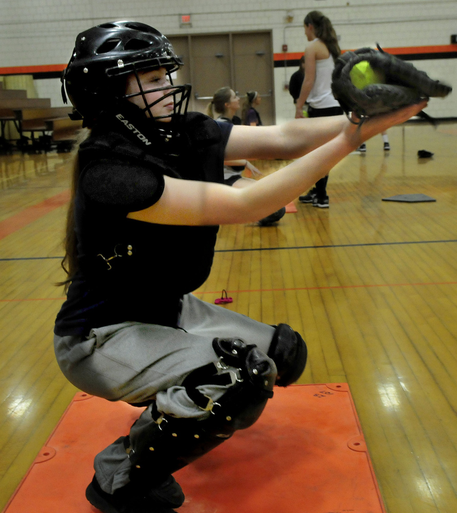 Skowhegan Area High School catcher Julia Steeves works out pitchers during an indoor practice session earlier this spring. Steeves joins Sydney Reed as a strong catching duo for the Indians.