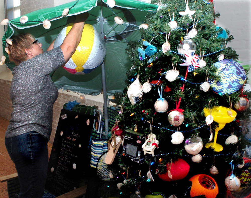 Sue Blaisdell decorates a tree Nov. 14, 2016, for the Sukeforth Family Festival of Trees at the Hathaway Creative Center in Waterville. Doug and Rita Sukeforth, the event's hosts, have been picked to receive the Mid-Maine Chamber of Commerce Community Service Project of the Year award.
