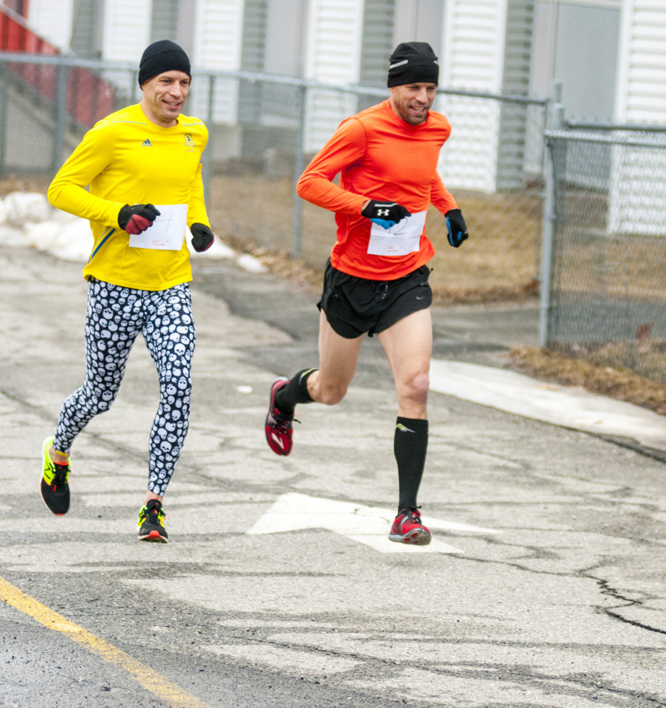 Ward Boudreau, left, and twin brother Wade Boudreau were off to an early lead in the Tiger 5k Run last Saturday at Gardiner Area High School. They're both going to be running the Boston Marathon on Monday.