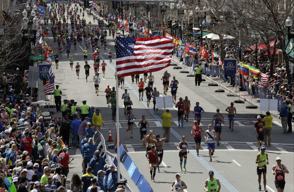Runners head down the stretch to the finish line in the 121st Boston Marathon on Monday.