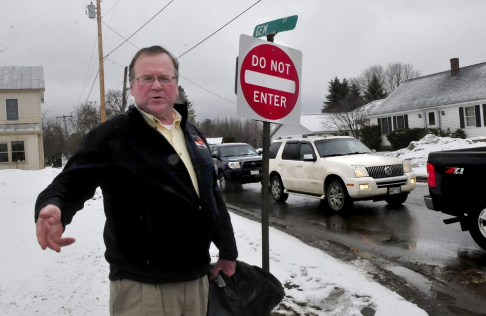 Skowhegan Road Commissioner Greg Dore stands earlier this month at the intersection of Gem Street and North Avenue in Skowhegan where Gem Street became a one-way road on Monday in hopes of relieving traffic congestion and slowing down traffic.