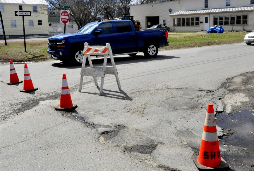 Traffic passes one way on Gem Street in Skowhegan on Monday past cones set up to alert drivers the roadway is no longer a two-way road.
