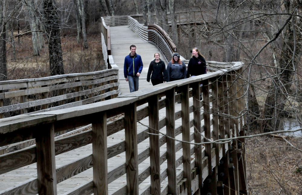 A group of Unity College students pass over the Community Bridge on Tuesday on the Hills-to-Sea Trail near the beginning of the 47-mile trail from Unity to Belfast. From left are Gunnar Norback, Rae-Ann MacLellan-Hurd, Catherine Bilodeau and Samantha Marley.