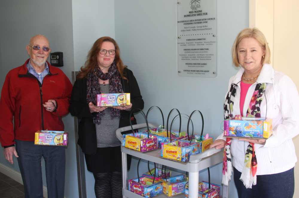 Contributed photo Three local lawmakers helped deliver Easter gift baskets Friday to the Mid-Maine Homeless Shelter in Waterville. From left are Rep. Thomas Longstaff, D-Waterville, Rep. Colleen Madigan, D-Waterville, and Rep. Catherine Nadeau, D-Winslow.
