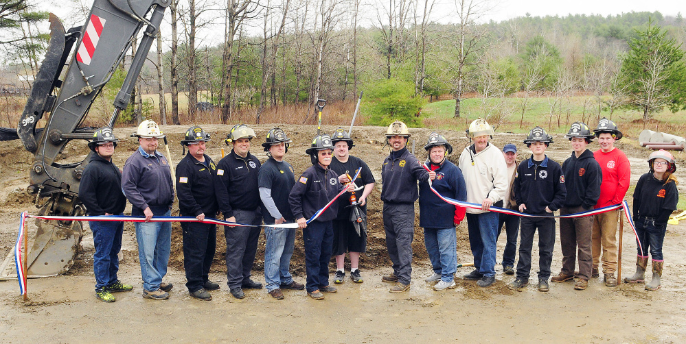 Pittston firefighters pose for a photo during a ceremonial groundbreaking for the new fire station Saturday in East Pittston.