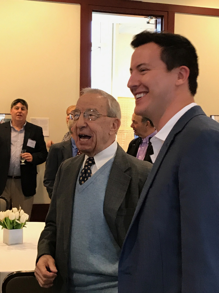 """John """"Swisher"""" Mitchell, left, enjoys a laugh with Colby College alum Mac Simpson on Saturday in Waterville. Colby celebrated Mitchell's 90th birthday by endowing the men's basketball assistant coaching position in Mitchell's name."""
