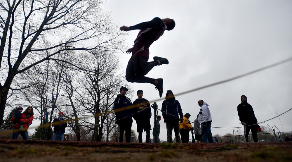 Maine Central Institute's Devon Varney jumps 16-11 in the long jump at the Waterville Relays on Saturday in Waterville.