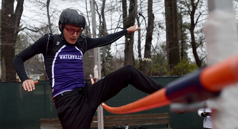 Waterville Senior High School's Taylor Bielecki knocks over the clearing bar on his first attempt on the pole vault at the Waterville Relays on Saturday in Waterville.