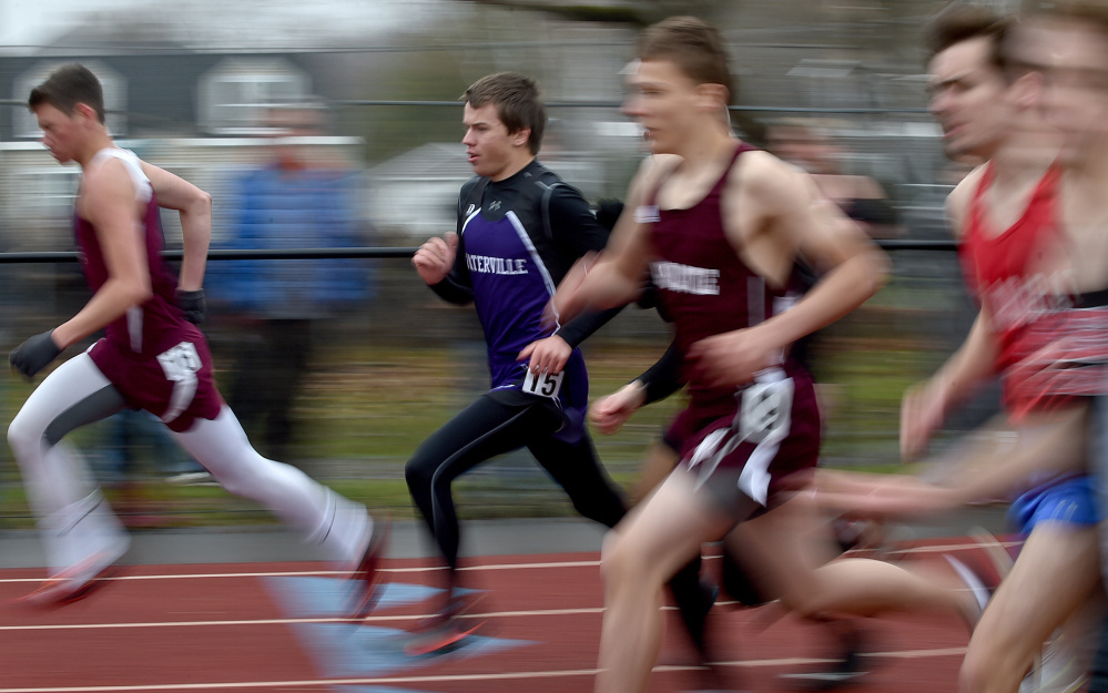 Waterville Senior High School's Connor Dolan, left center, competes in the 1,600 meter run at the Waterville Relays on Saturday in Waterville.