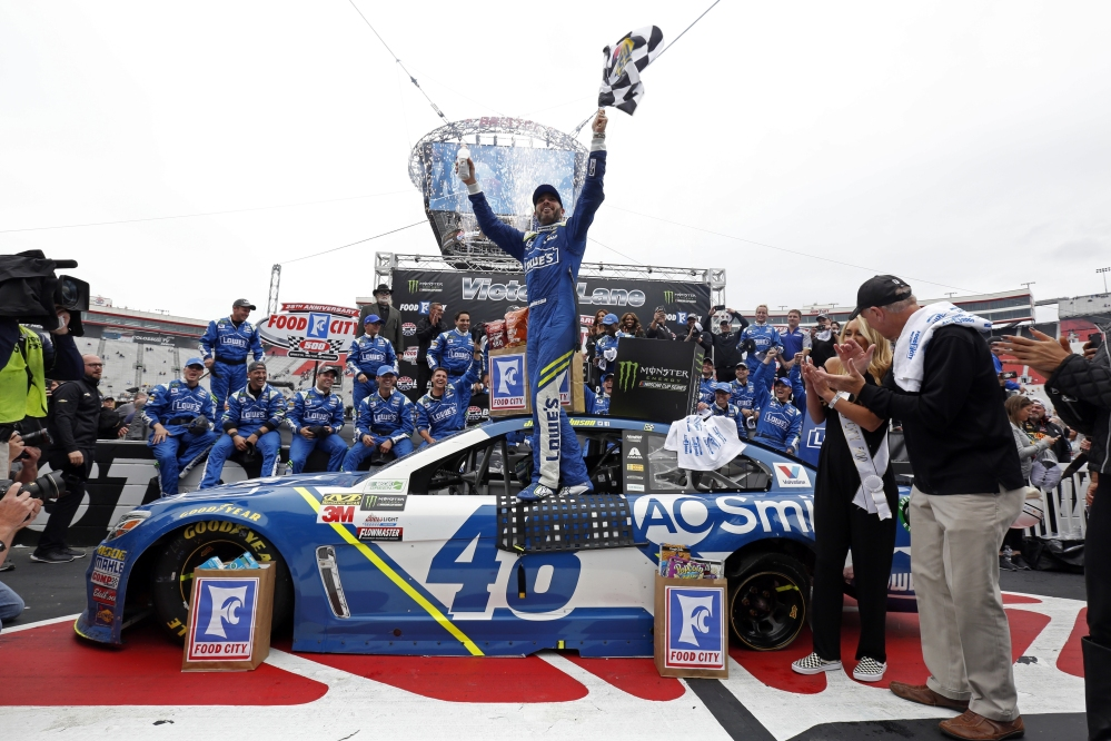 Driver Jimmie Johnson celebrates after winning the Monster Energy NASCAR Cup Series rac, Monday in Bristol, Tennessee.