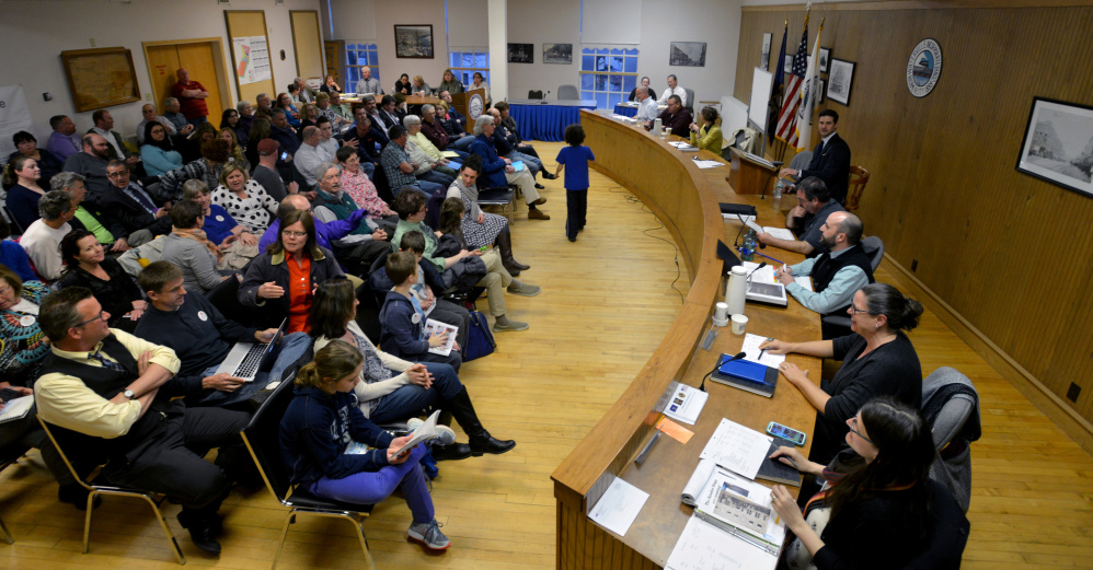 Community members and city councilors gather Tuesday for a school budget meeting at the The Center in downtown Waterville.
