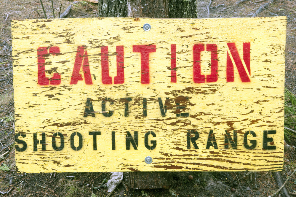 Staff photo by Joe Phelan A warning sign is seen Thursday at the West Gardiner Rod & Gun Club gun range behind the clubhouse.