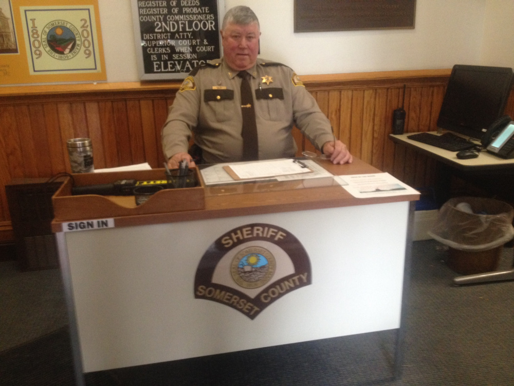 "Somerset County sheriff's Deputy Mike Cray sits at his new work station as a security officer in the Somerset County Courthouse in Skowhegan. Cray, of Palmyra, started his new duties April 1. Somerset County Administrator Dawn DiBlasi said things were getting ""more and more volatile"" in courthouses across the state."