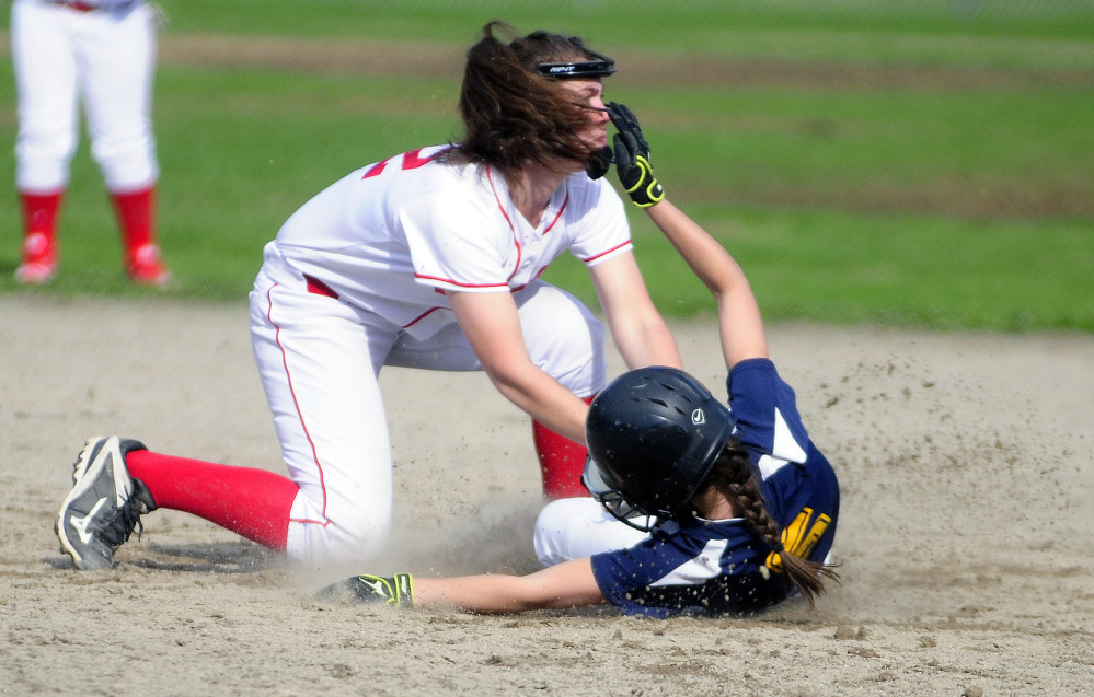Cony shortstop Carly Lettre, top, tags out Mt. Blue's Samantha Ellis during a game Friday at Newman Brann Memorial Field in Augusta.
