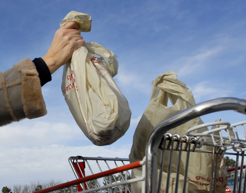 More than 150 communities nationwide have passed laws to encourage the use of environmentally friendly reusable bags.  Shawn Patrick Ouellette/Staff Photographer