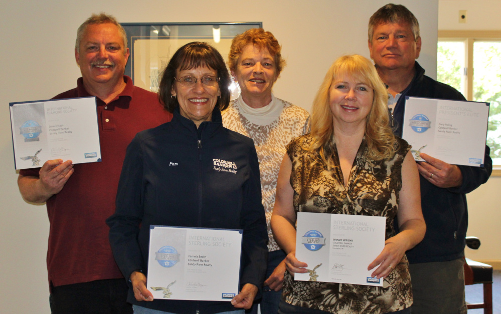 Sandy River Realty Coldwell Banker National's 2016 award winners are, in front from left, Pamela Smith and Wendy Wright; and at rear from left, Dan Nash, Juanita Bean Smith and Gary Paling.