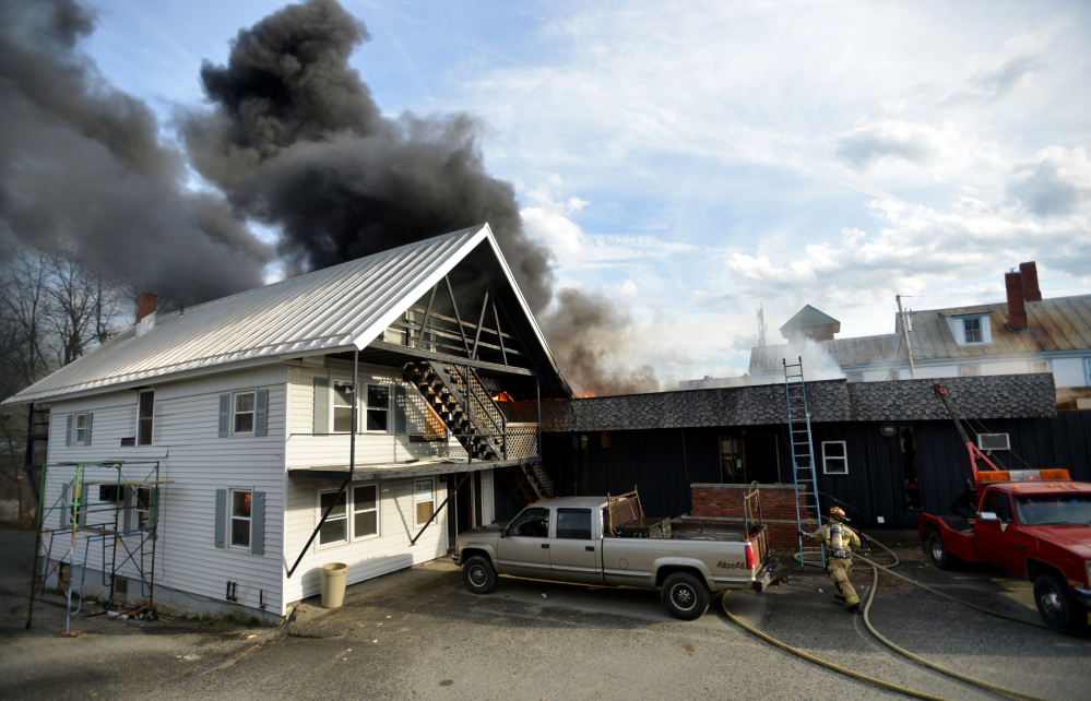 Firefighters battle a fire on College Avenue in Waterville on Saturday.