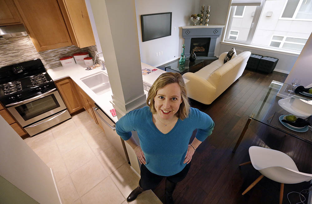 Kathleen Mulcahy stands in her recently sold, one-bedroom condo, for which she received nearly two dozen offers and sold for more than $100,000 over her asking price, in Seattle's Belltown neighborhood. Many would-be buyers, especially in the big cities, will be wading into a market that's crowded with rival buyers and constrained by the lowest inventory of homes for sale in nearly two decades.