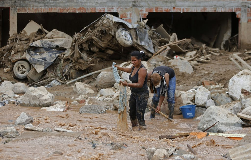 Survivors recover their belongings in Mocoa, Colombia, on Sunday.