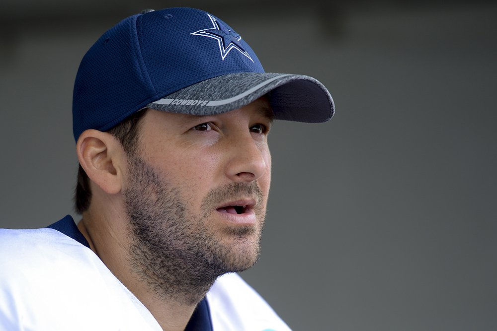 Tony Romo talks to reporters at the end of a team practice in Oxnard, Calif., last September. Romo, who turns 37 this month, was trying to recover from a series of back injuries that included two surgeries in less than a year.