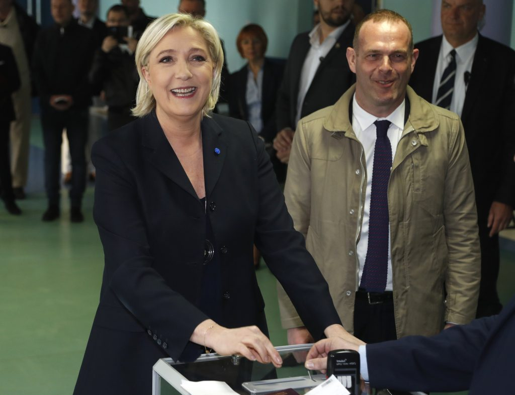 Far-right leader and candidate for the 2017 French presidential election Marine Le Pen casts her vote in the first-round presidential election in Henin-Beaumont, France, on Sunday.