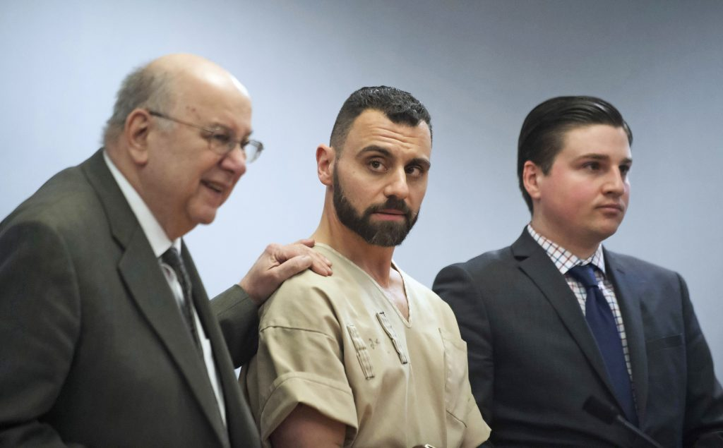 Richard Dabate, center, appears with attorneys while being arraigned on April 17, 2017, in Rockville Superior Court in Vernon, Connecticut.