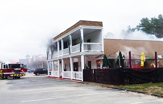 Firefighters work to extinguish a fire at A La Mexicana restaurant in Raymond on Wednesday.