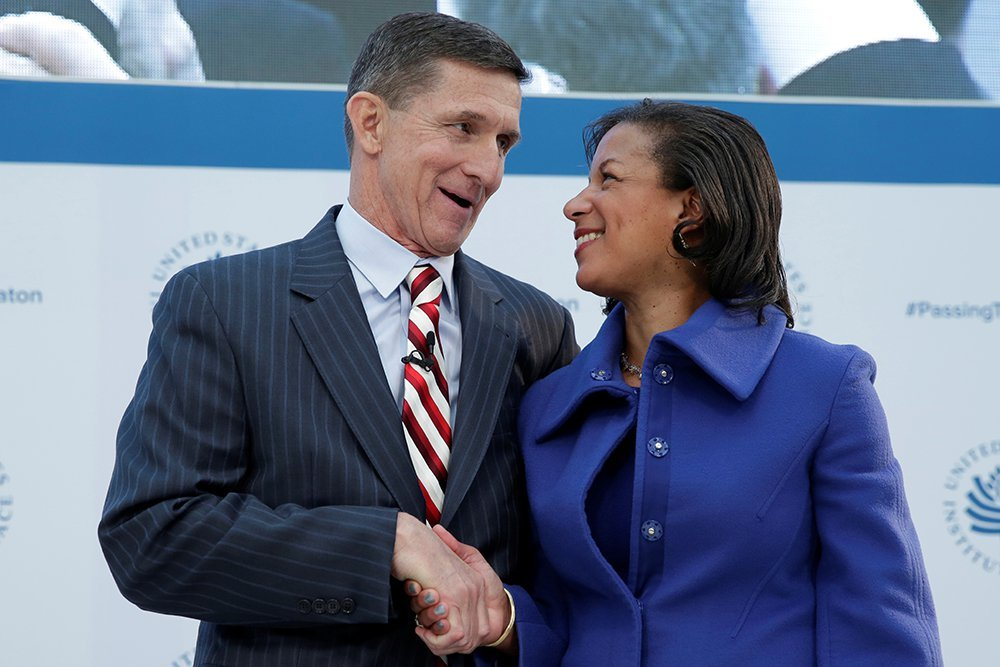 Then-White House National Security Adviser Susan Rice shakes hands with Michael Flynn, who had been Defense Intelligence Agency director under Obama and would briefly serve as Trump's national security adviser, at a U.S. Institute of Peace conference in Washington on Jan. 17, 2017.