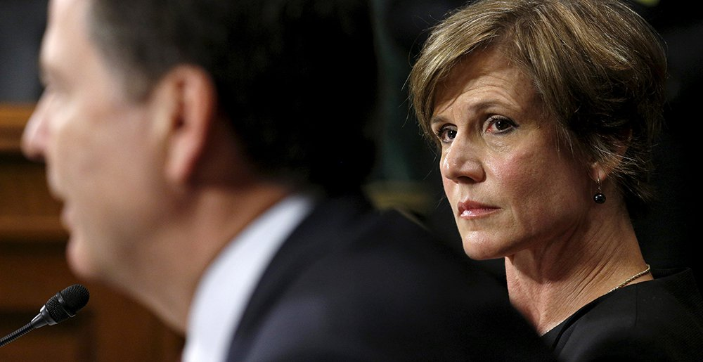 Then-Deputy Attorney General Sally Yates listens as FBI Director James Comey speaks during a Senate hearing on July 8, 2015.