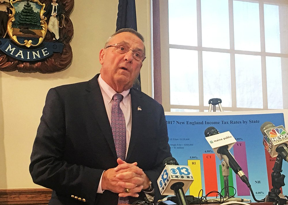 Gov. Paul LePage talks to the news media at the State House on Monday.