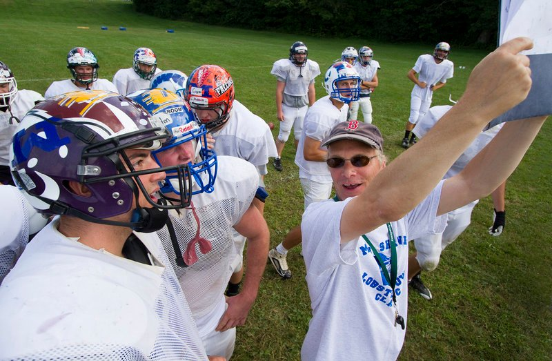 Western Maine Head Coach Jimmy Alyward calls a play during practice and media day at Hebron Academy in Hebron, Maine on Tuesday, July 19, 2011.
