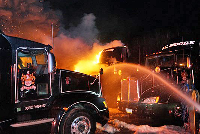 Trucks burning Sunday night at the R.C. Moore depot on Spring Water Road in Poland.