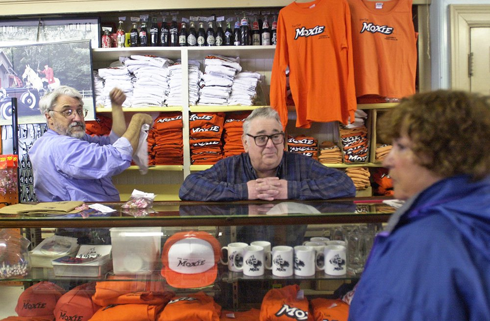 Frank Anacetti waits on a customer in 2003 at his Lisbon Falls store, which had been selling Moxie since it opened in 1914.