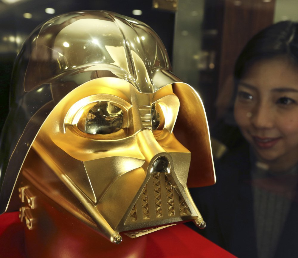 "A jewelry store in Tokyo is taking orders for masks of ""Star Wars"" villain Darth Vader. It's 33 pounds of pure gold and costs $1.4 million."