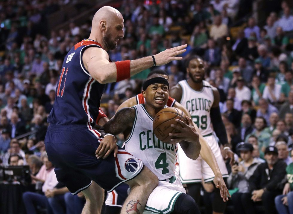 Boston Celtics guard Isaiah Thomas drives to the basket against Washington Wizards center Marcin Gortat, left, during the first quarter Tuesday in Boston.